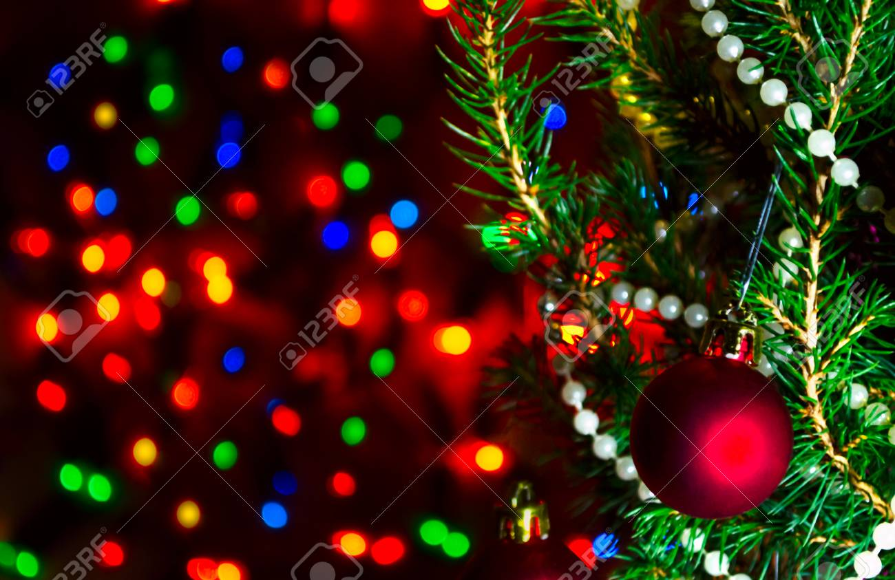 Red Christmas Ball On Christmas Tree With Blurred Lights Christmas Stock Photo Picture And Royalty Free Image Image 113771358