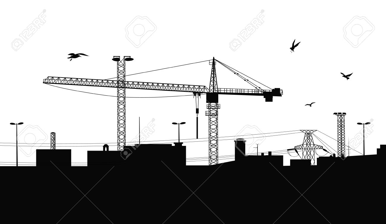 silhouette of a buildings being built with a crane on the