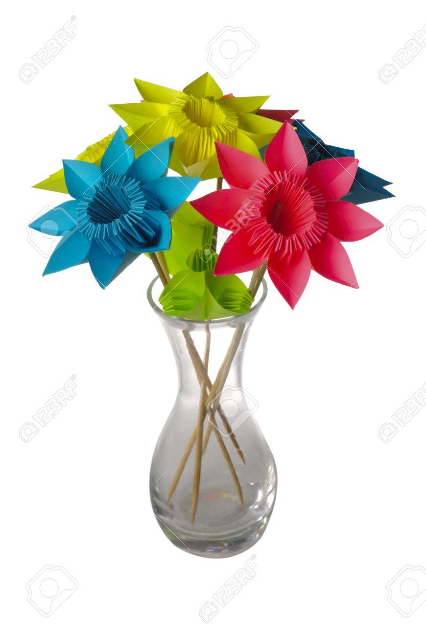 275 & Origami flowers in glass vase isolated on white.