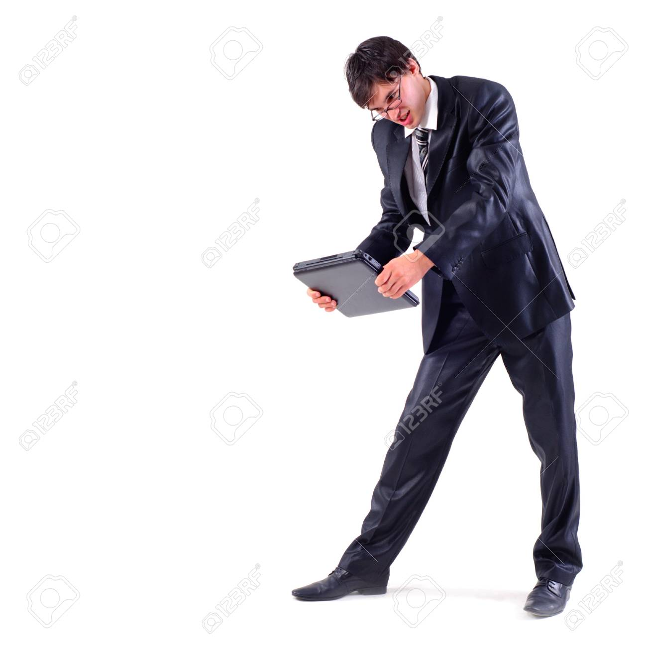 angry businessman want to crack the laptop, isolated on white Stock Photo - 7642570
