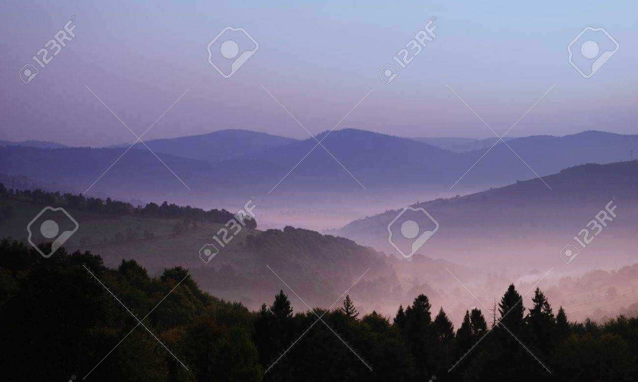 beautiful view of mountainsides in the morning fog above Carpatian mountains Stock Photo - 8991658