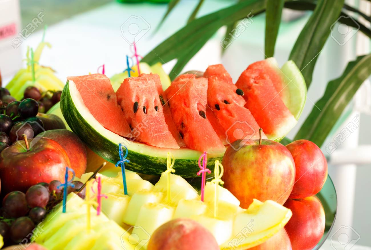 Various slices of fruits on the mirror stand prepared for eating Stock Photo - 10595189