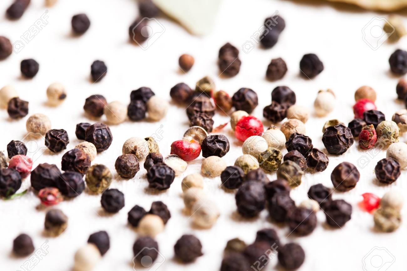 Different peppercorns on white napkin closeup Stock Photo - 13306164