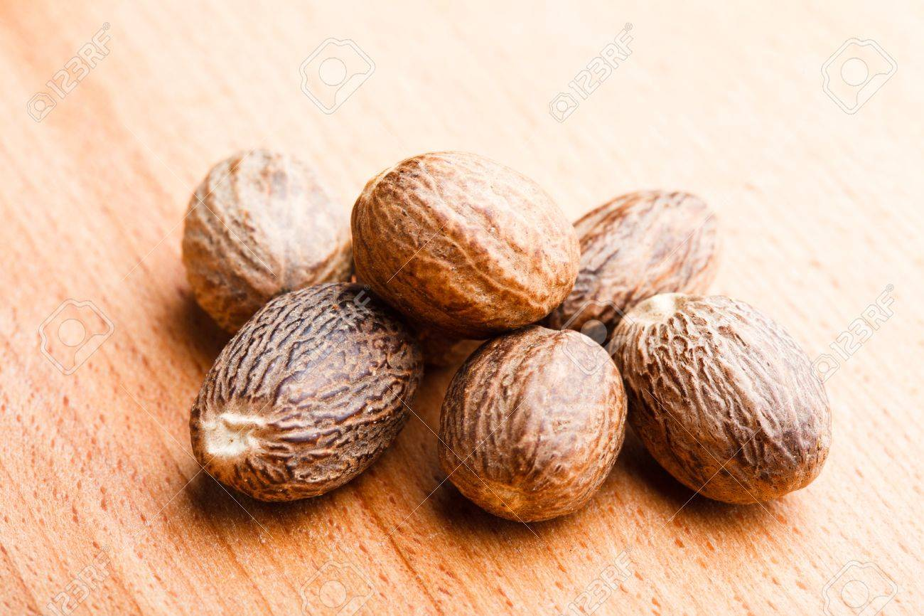 Mace spice scattered on wooden table Stock Photo - 13306179