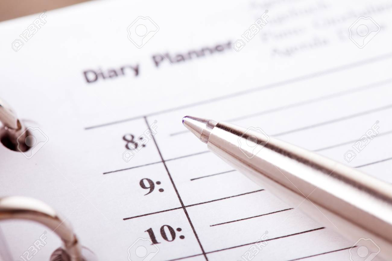 The day organizer page and pen closeup Stock Photo - 16396857
