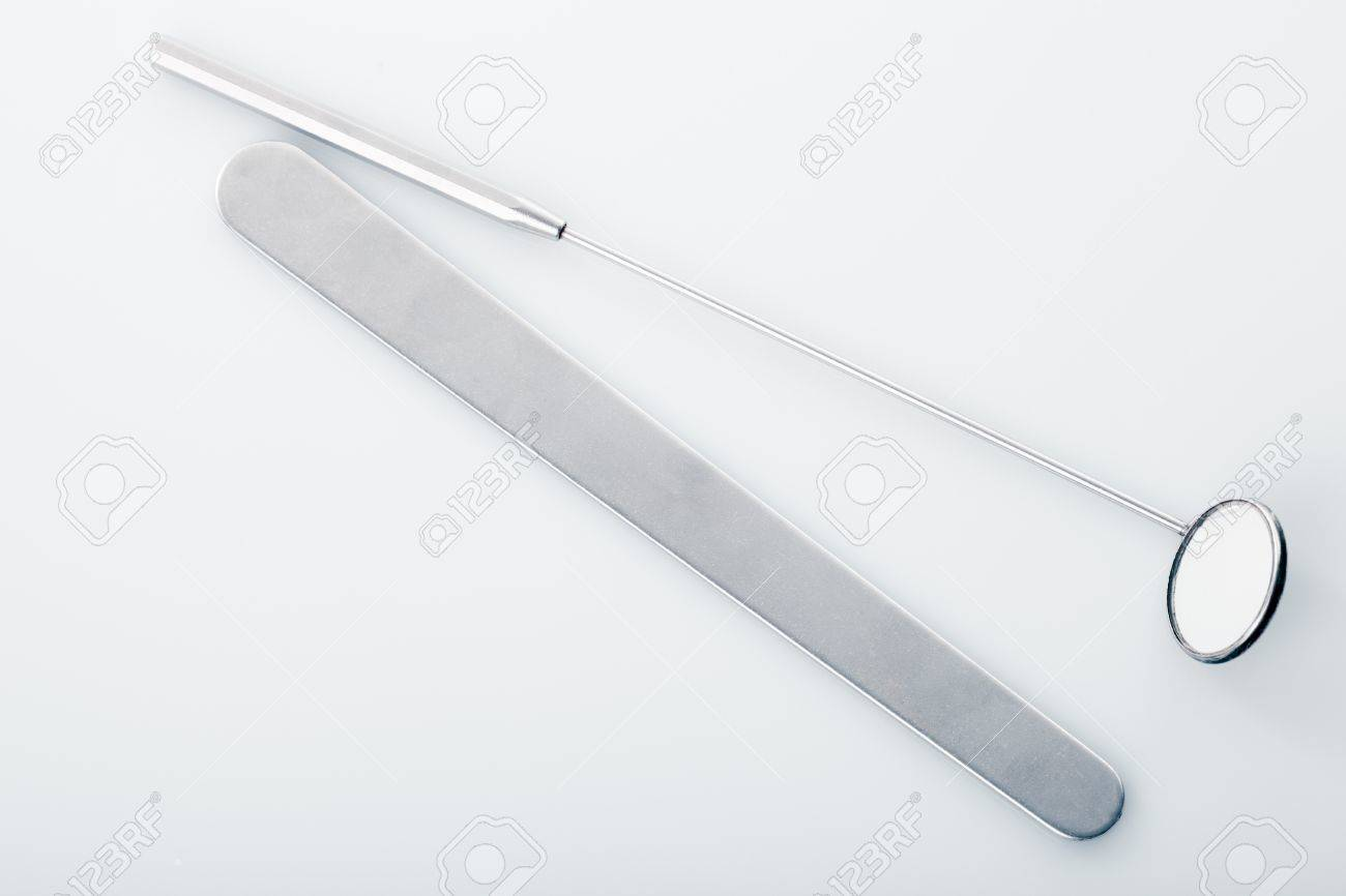 Medical instruments for ENT doctor: mirror and scapula for throat. Diagnostic concept Stock Photo - 17304701