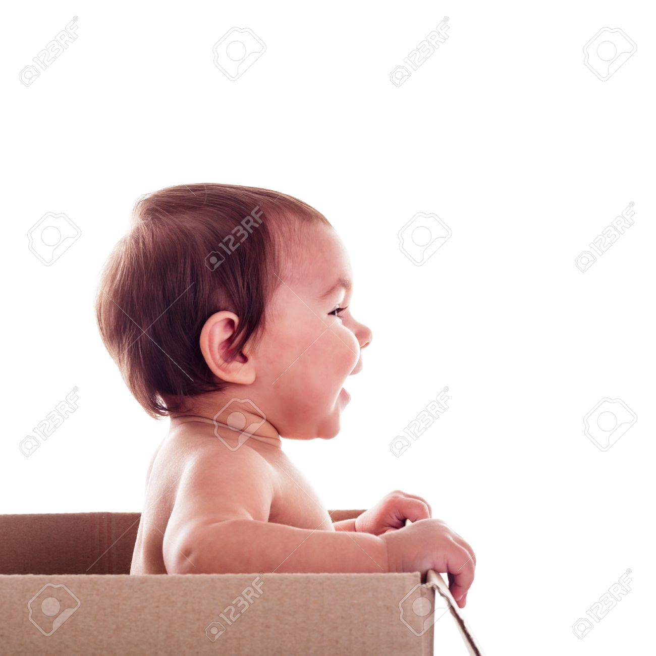 A small child (baby) in  the box isolated, side view Stock Photo - 17287753