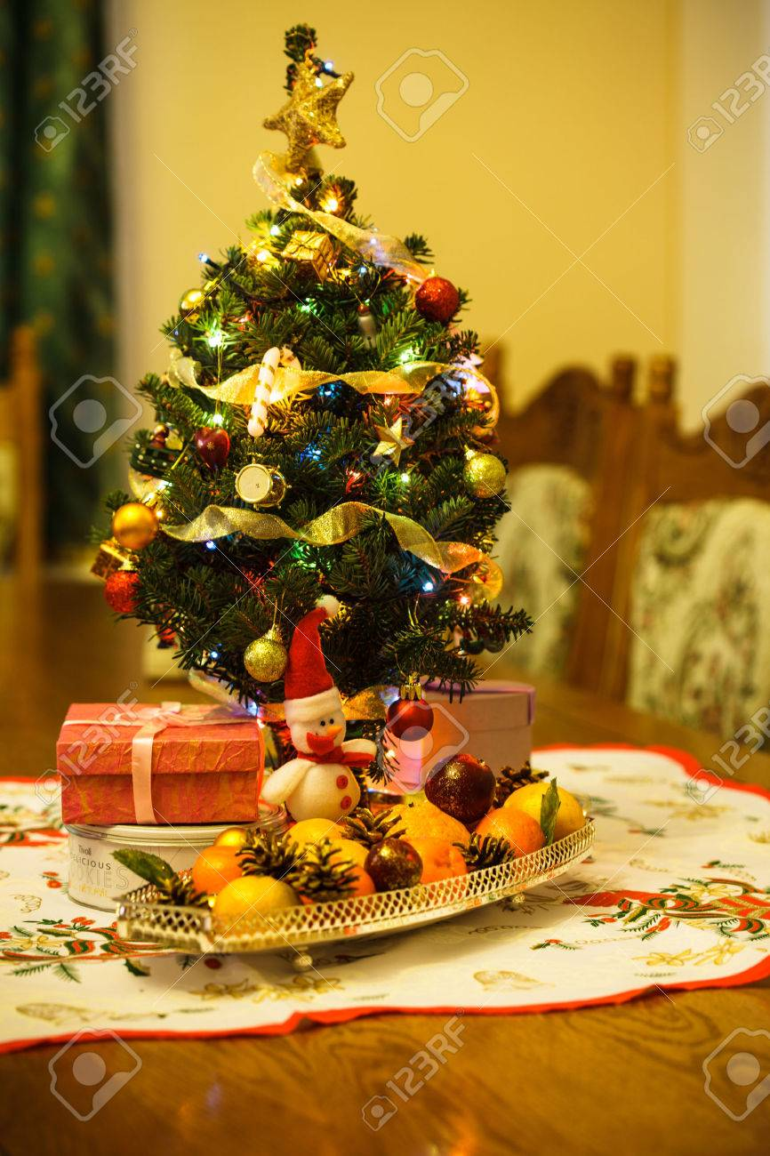 Small Christmas Tree With Decorations Gifts And Citrus On The Stock Photo Picture And Royalty Free Image Image 22360295