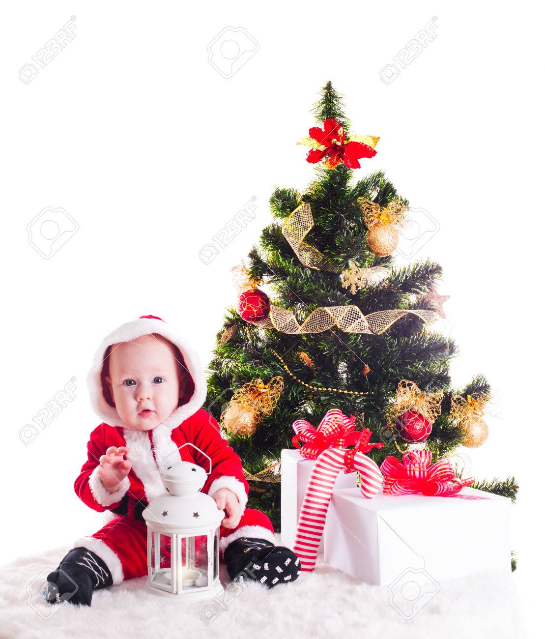 Christmas Baby Under The New Years Tree With Gifts Stock Photo ...