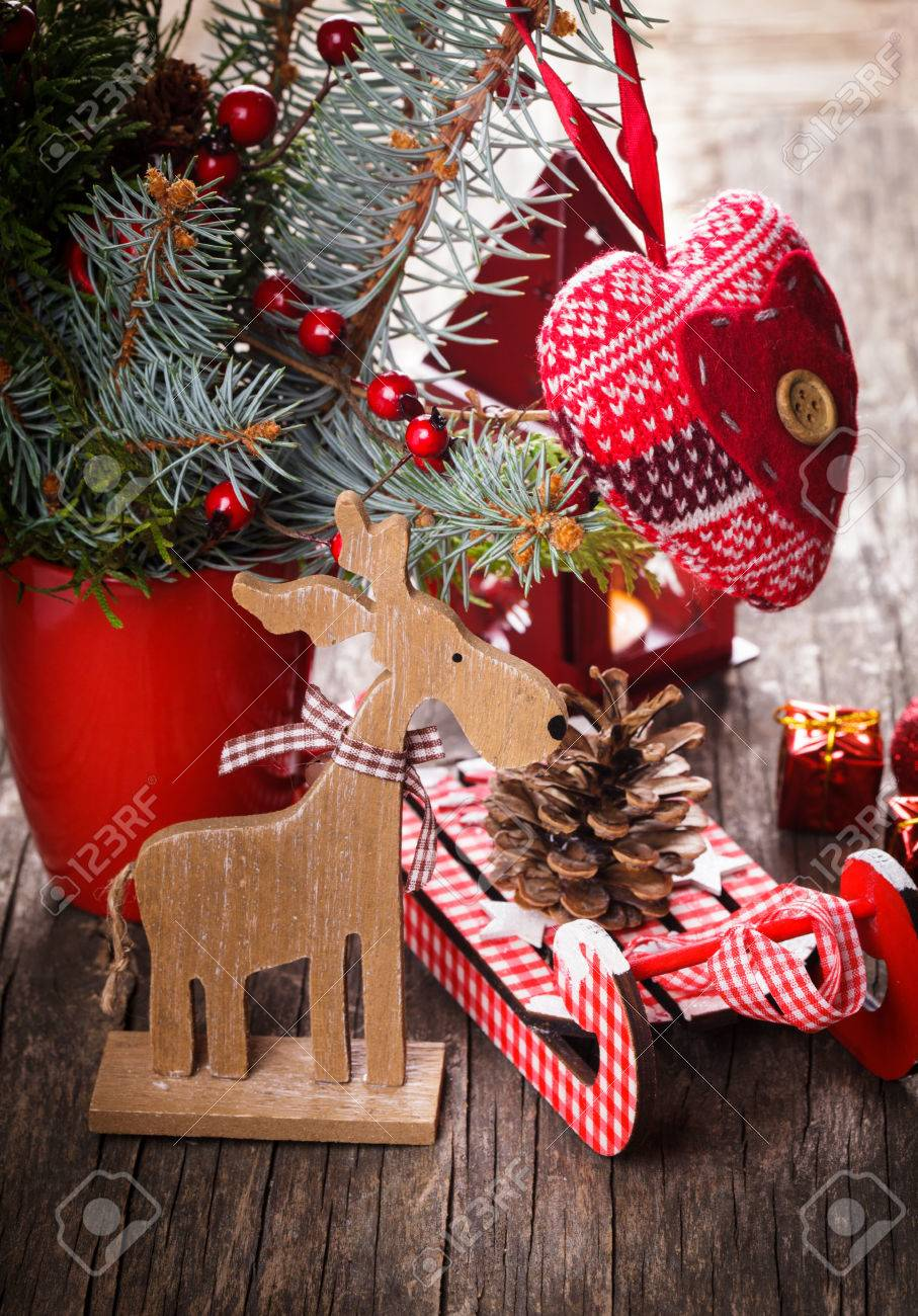 Christmas decorations heart deer and sleds on old wooden table