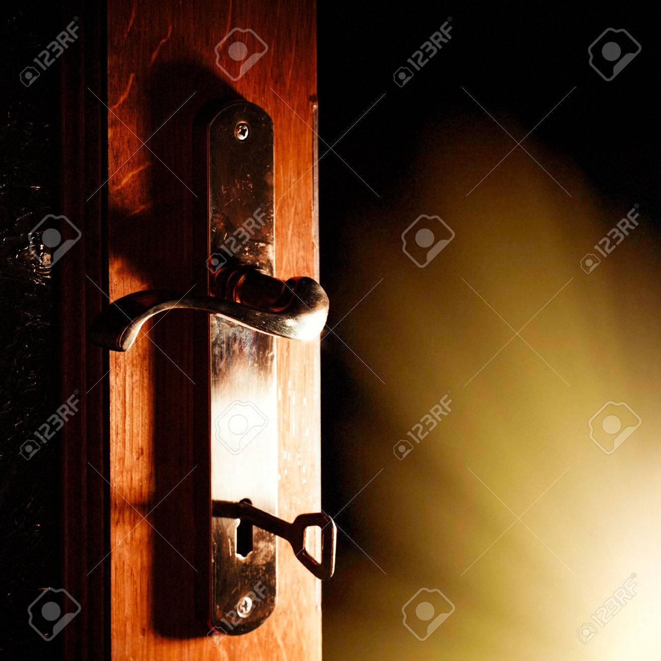 Open Door Dark Room open door with key into the dark room with light stock photo