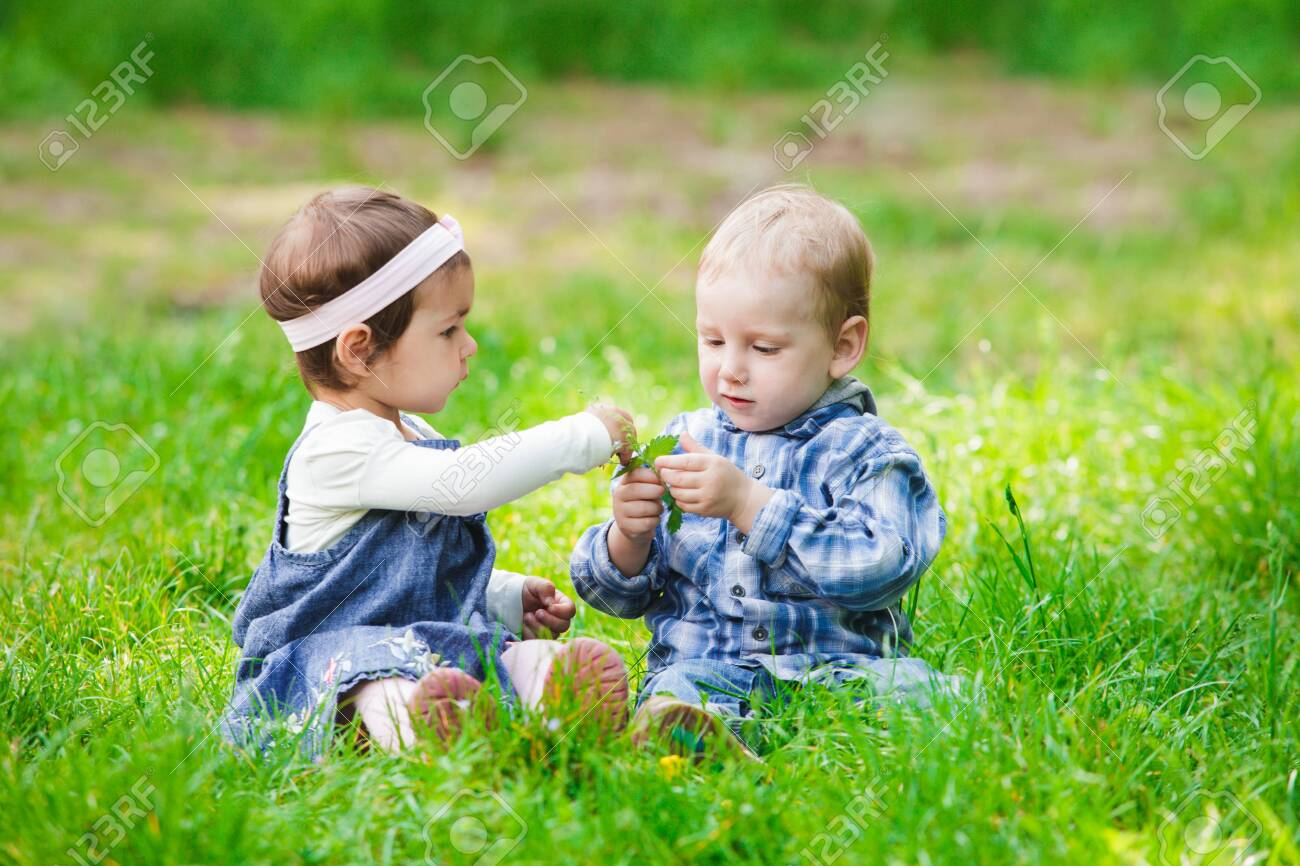 Little kids play outdoors on the grass Stock Photo - 27472573