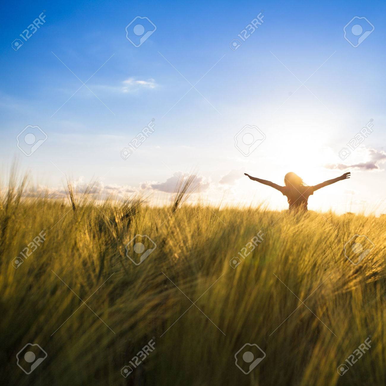 Teenage girl enjoy with sunshine in wheat field - 42340565