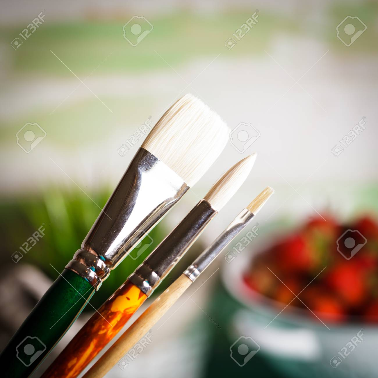 Various Types Of Paint Brushes Over The Defocused Painting Stock