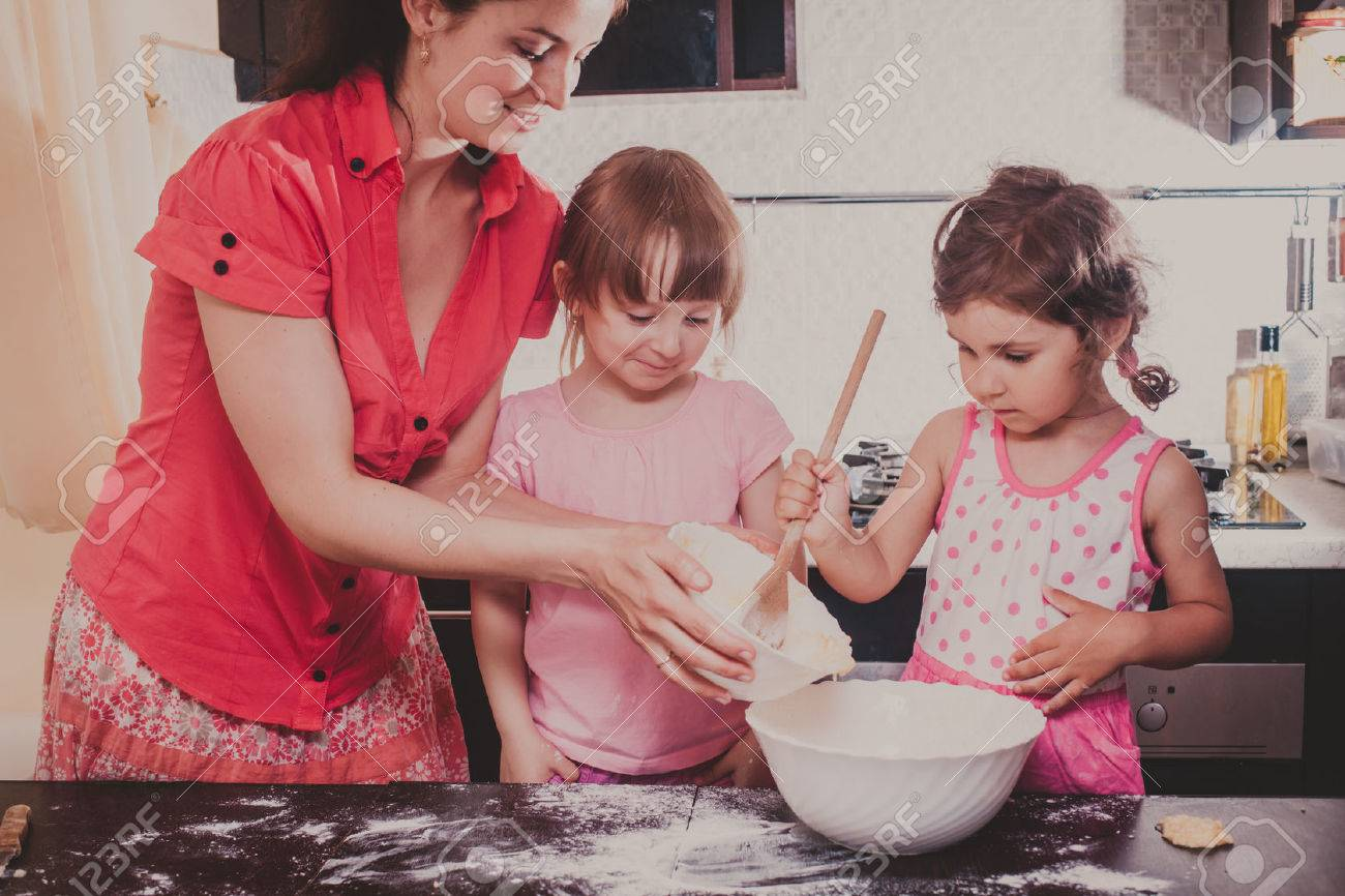 Mom Is Baking Cookies With Her Kids At Home Kitchen Stock Photo ...