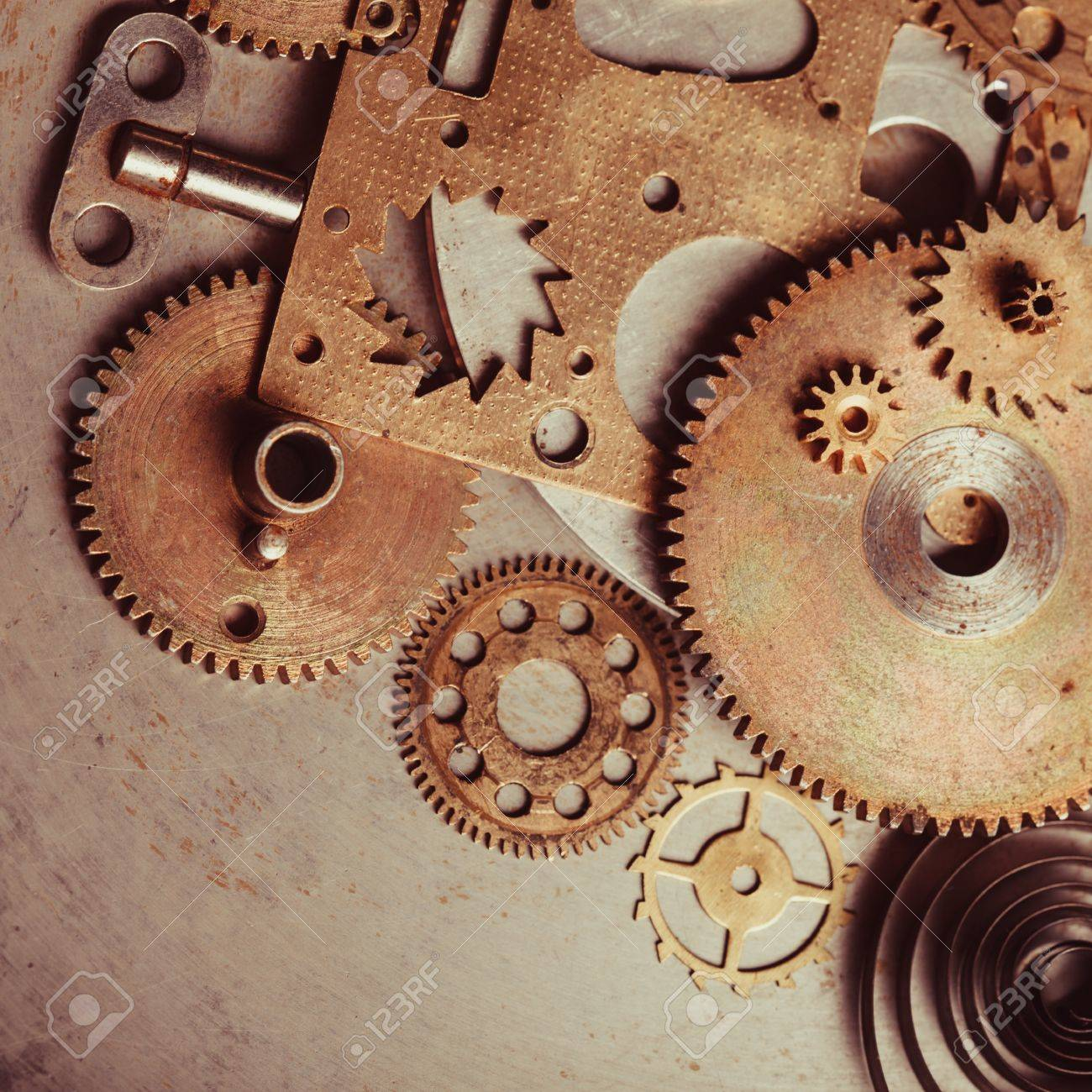 steampunk background from mechanical clocks details over old metal background inside the clock gears