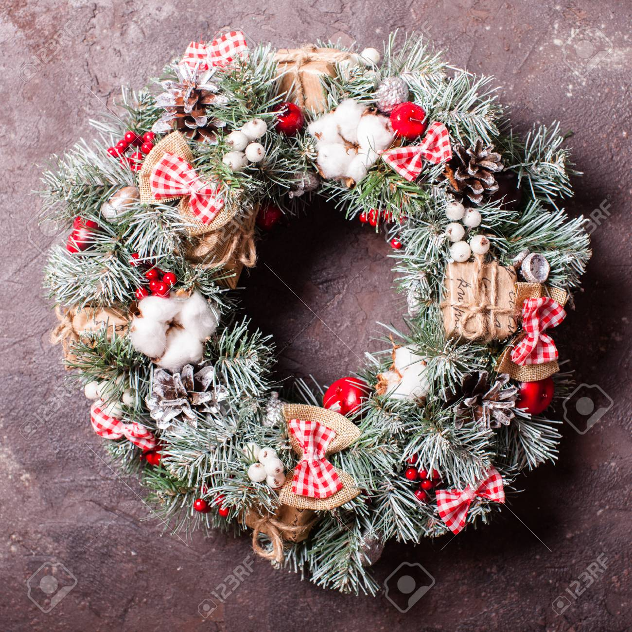 Red And White Christmas Wreath.Red And White Christmas Wreath With Bows And Cotton Flowers