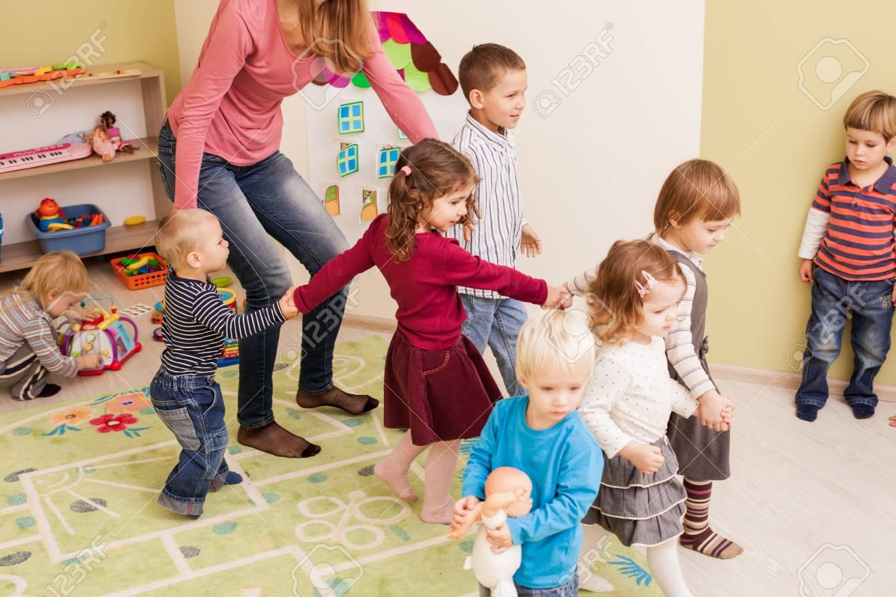 Group of little children dancing - 91968634