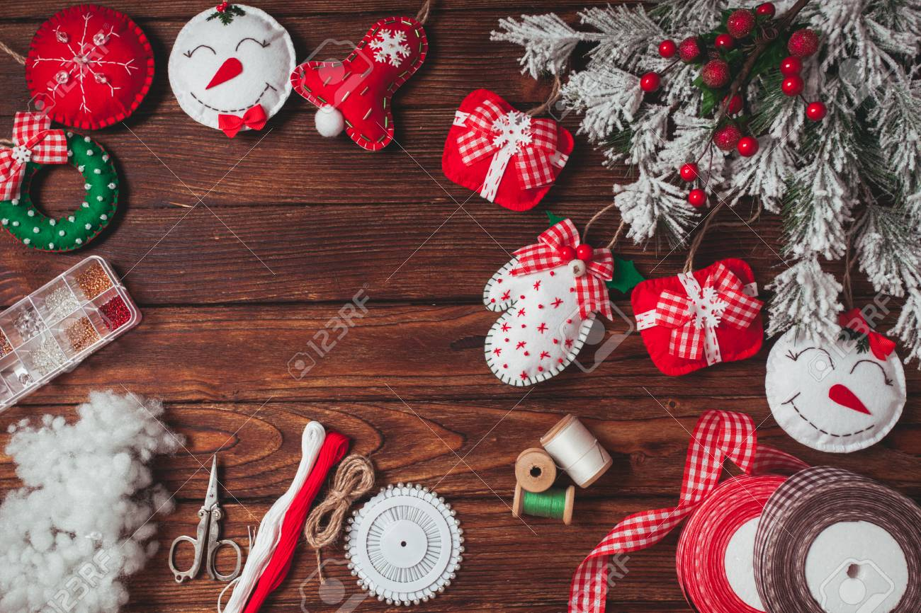 Felt Christmas Decorations On The Wooden Table Preparing For
