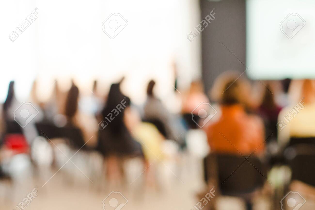 Blurred poeple sitting on the chairs at Conference and Presentation in the conference hall. Art perfomance - 130094680