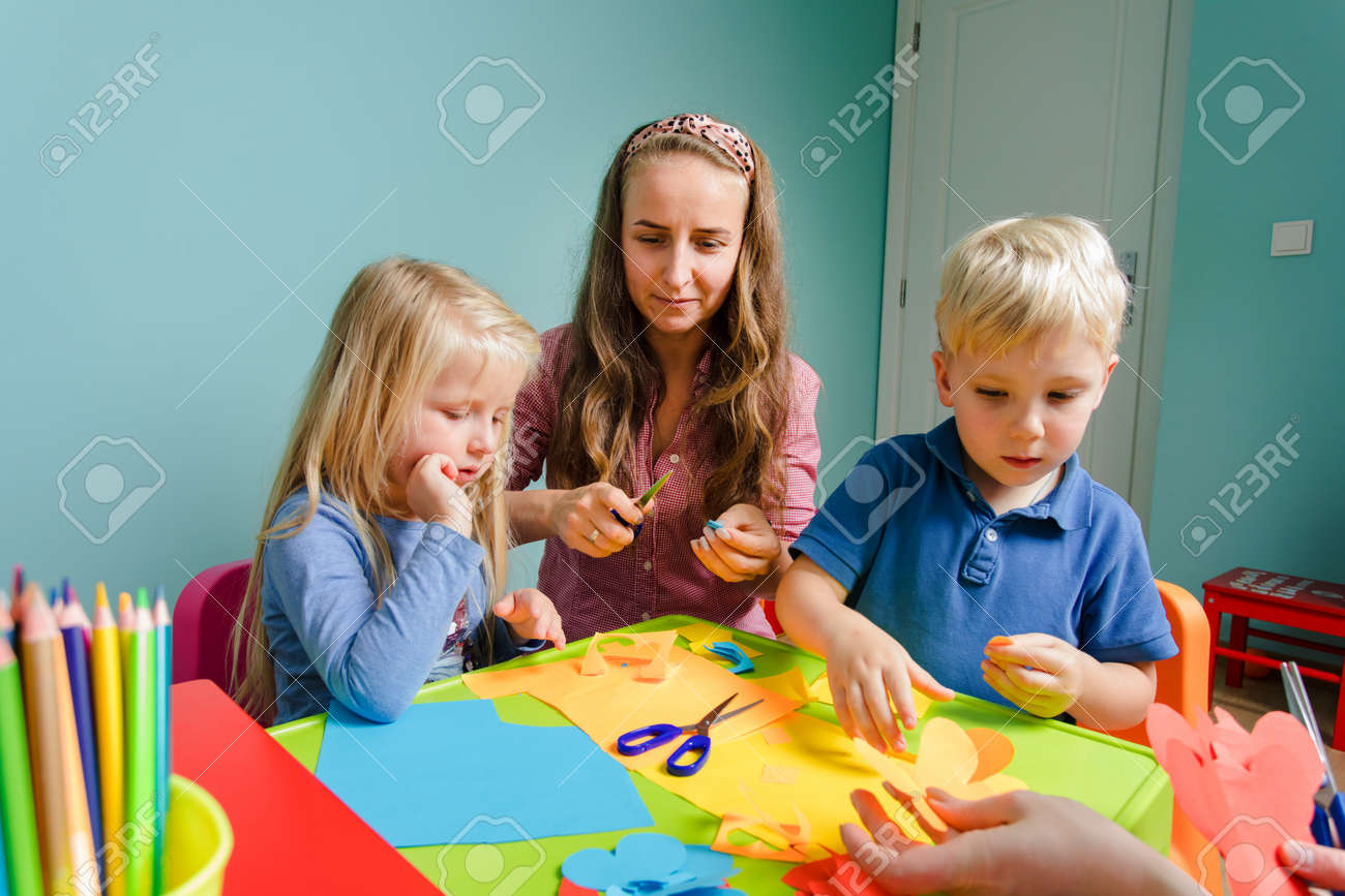 children and tutor study together at the creative school - 165322073