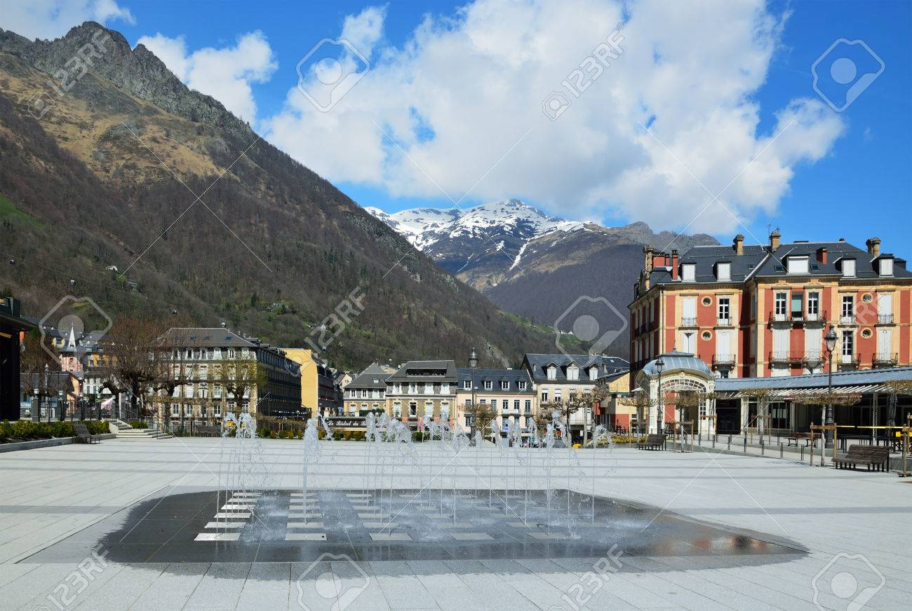 the town square with a fountain in cauterets ski resort among