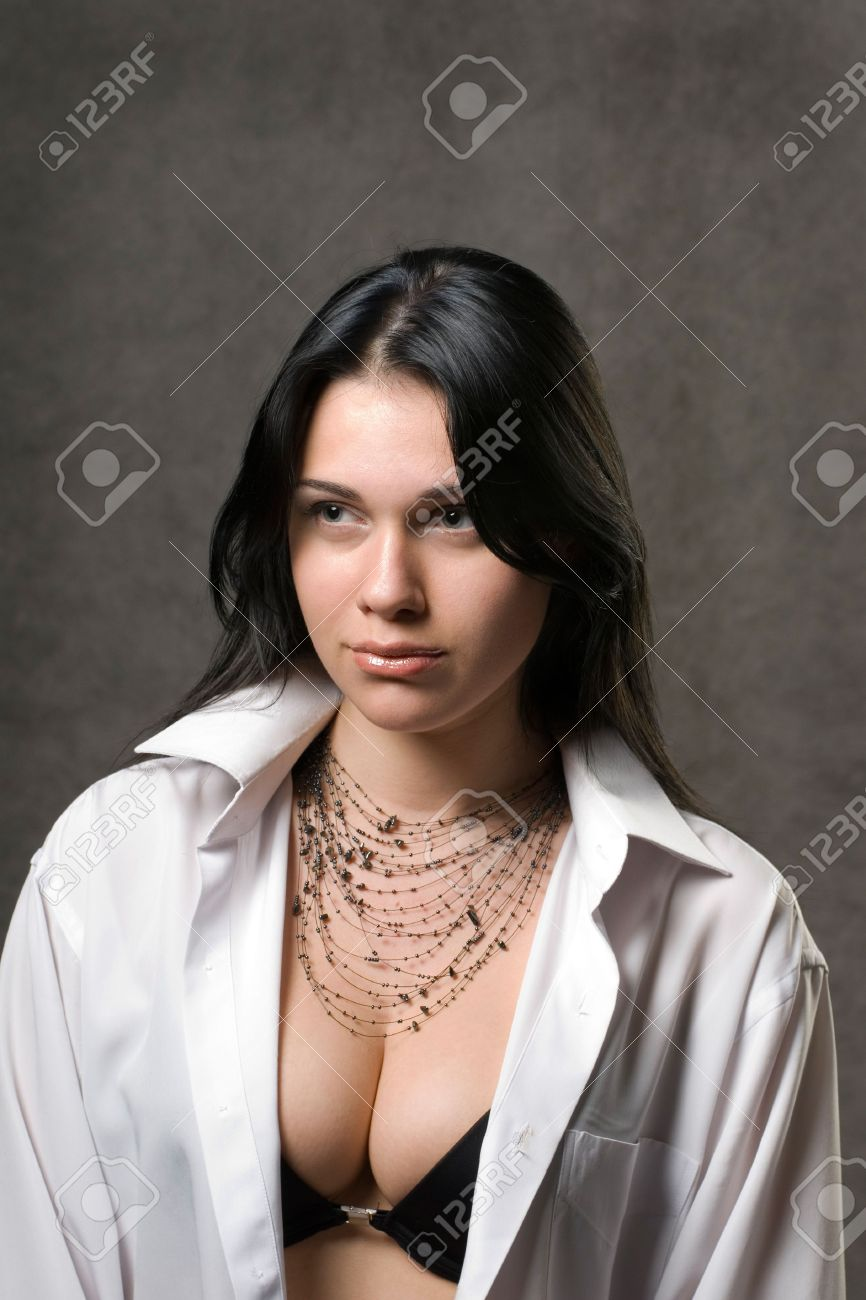 Sexy woman in a man's white shirt. Stock Photo - 6135929