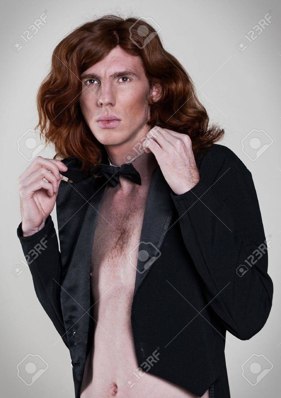 Beautiful, young man with the long, auburn hair Stock Photo - 12516012