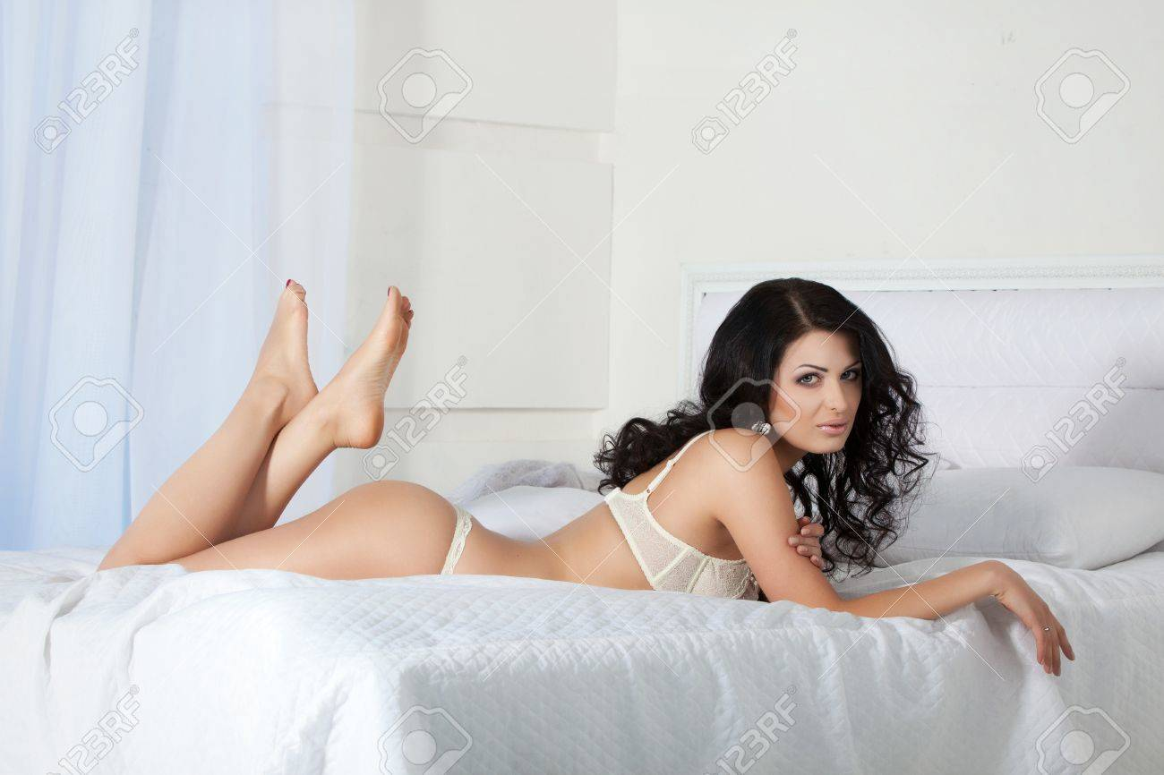 Beautiful woman in lingerie, lies on bed Stock Photo - 12856799