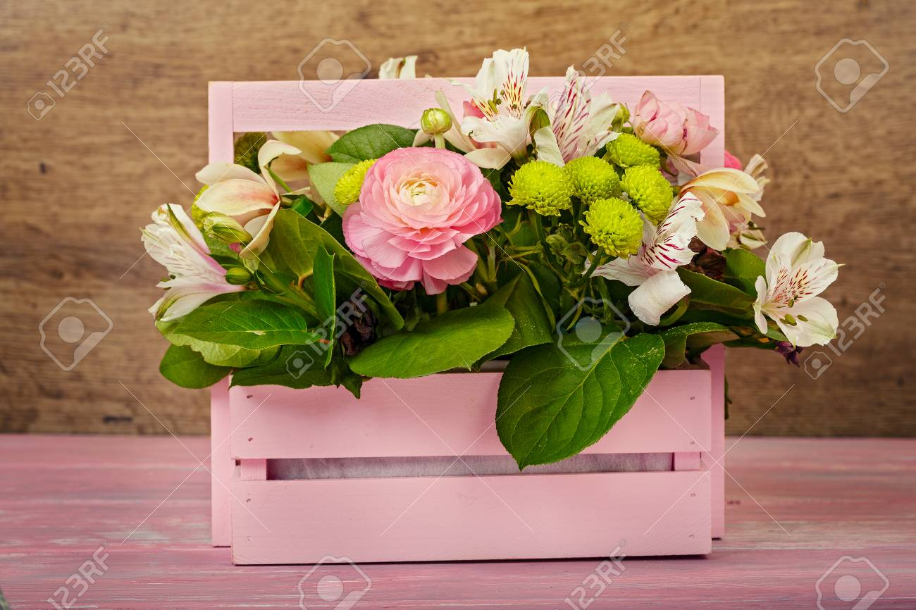 Arrangement With Flowers In A Pink Wooden Box Stock Photo Picture And Royalty Free Image Image 97482512