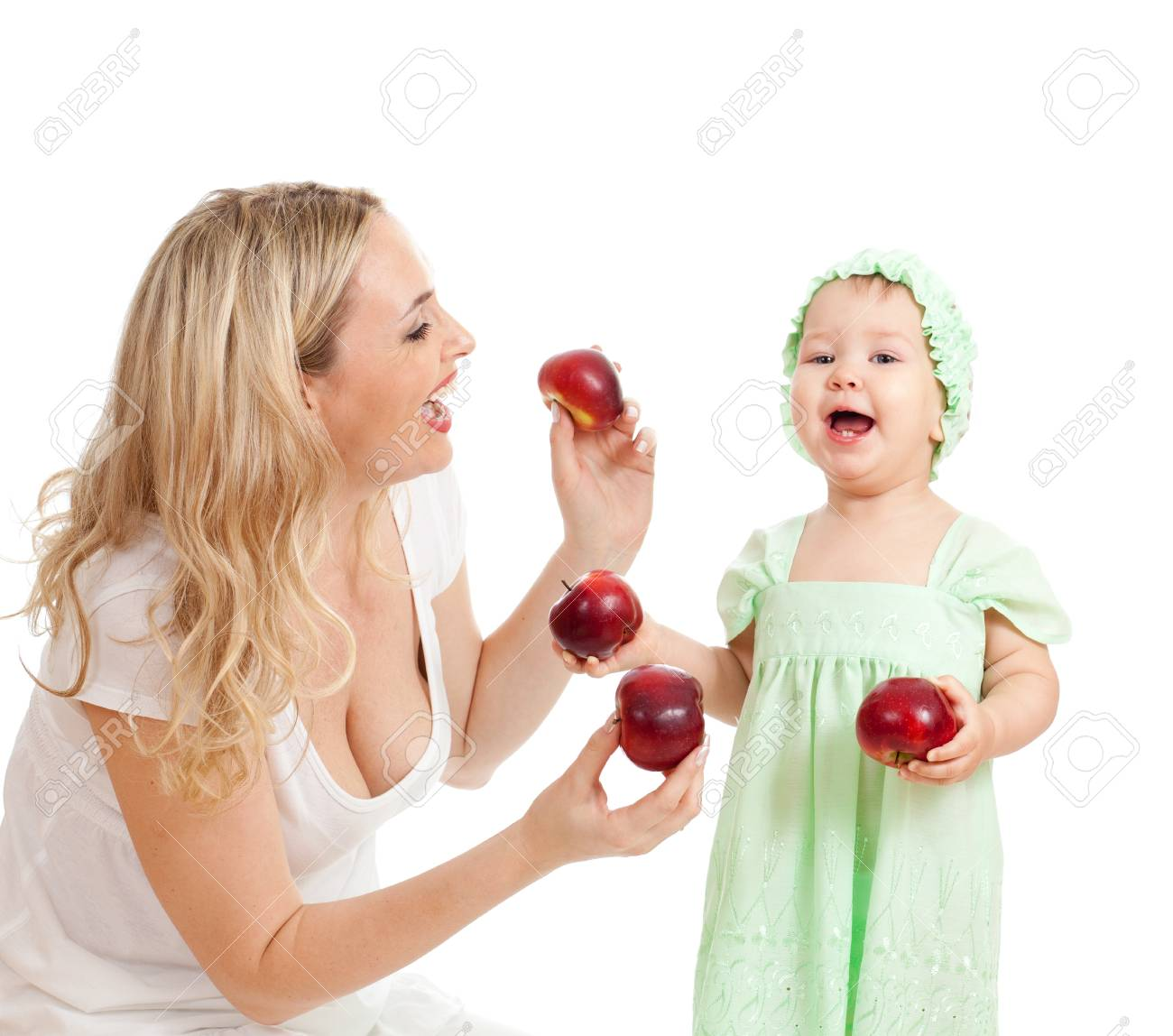 mother and her child with red apples Stock Photo - 11108182