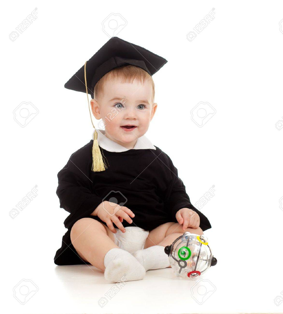 Baby in academician clothes  with Rubik Stock Photo - 11327489