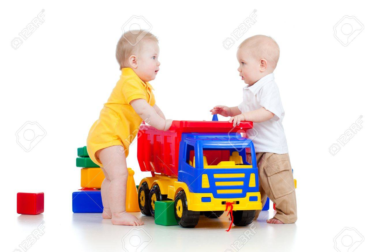 two little children playing with color toys and truck stock photo