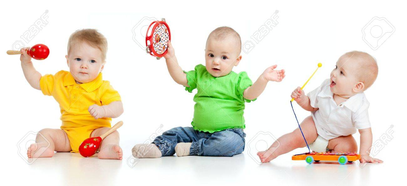 Children playing with musical toys  Isolated on white background Stock Photo - 12584166