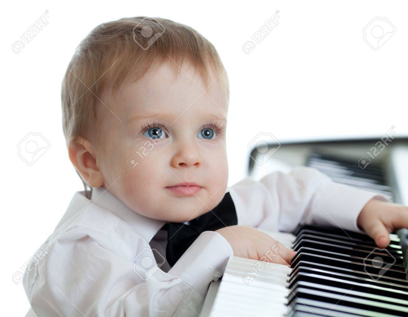 adorable child playing electronic piano Stock Photo - 12675567
