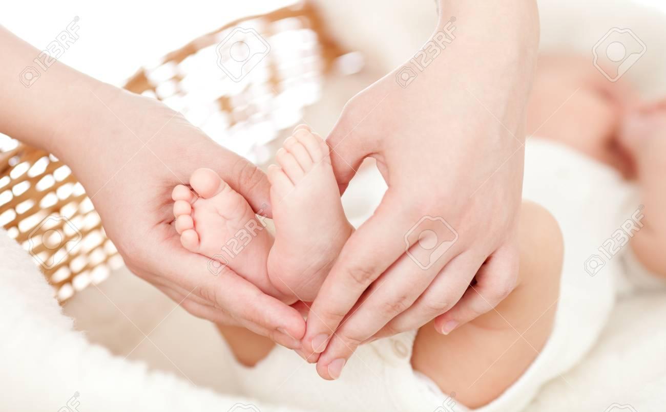 parent's hands keeping newborn baby's feet Stock Photo - 13633345