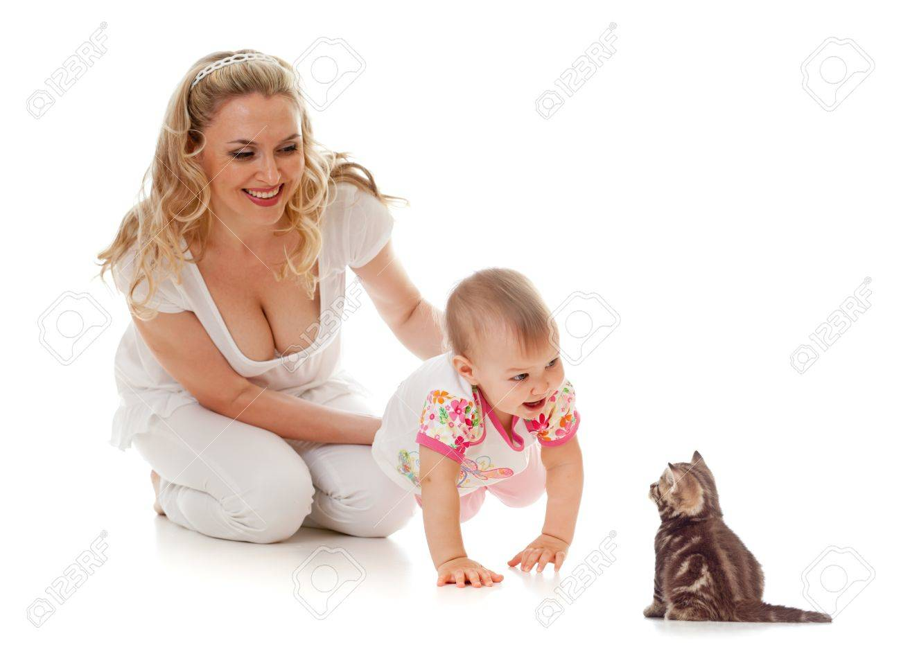 Kid and loving mother; girl steps on her hands forward to small kitten Stock Photo - 13702144