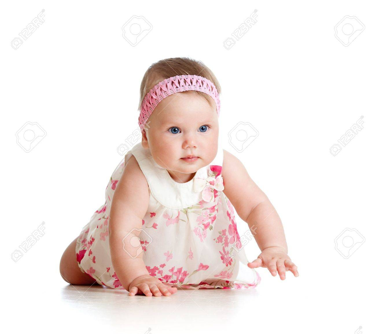 pretty baby girl crawling on floor stock photo, picture and royalty