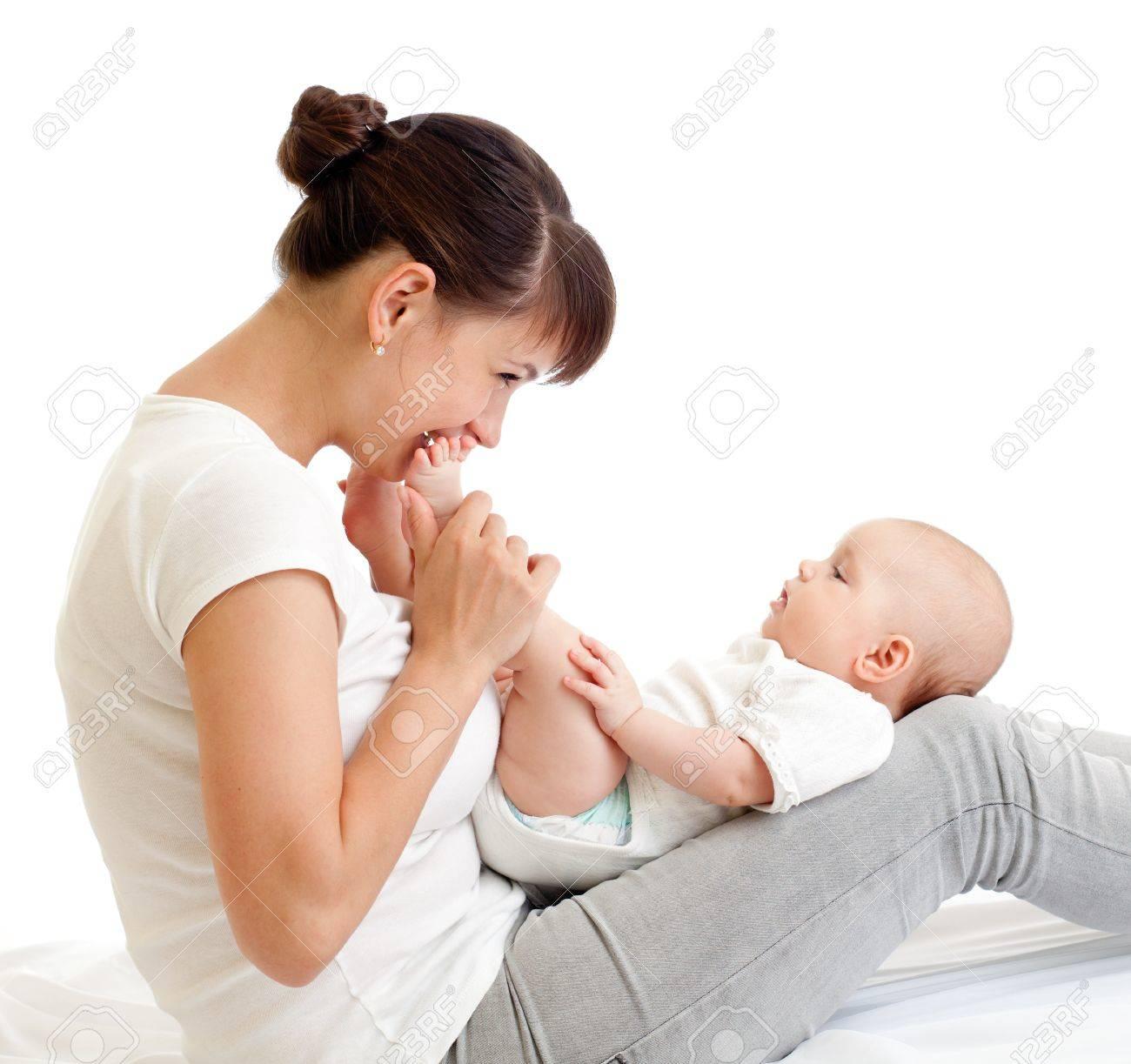 joyful mother kissing her baby infant Stock Photo - 13944553
