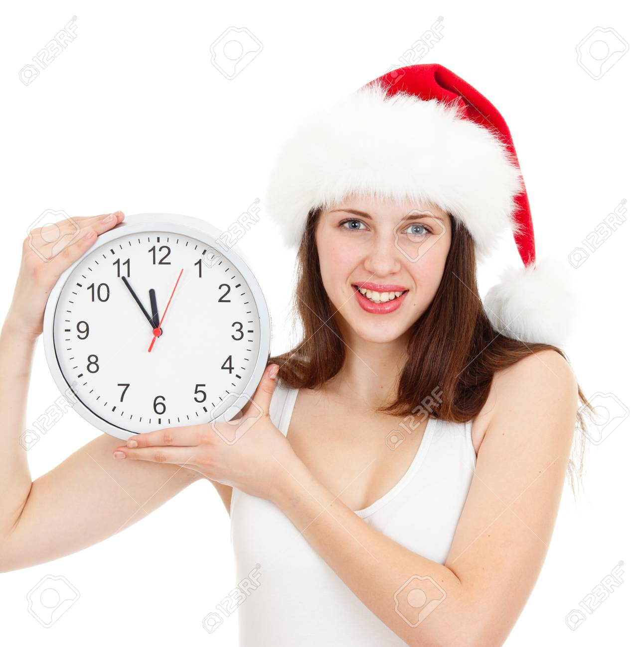 Cute girl in Christmas red santa hat with clock over a white background Stock Photo - 14726741