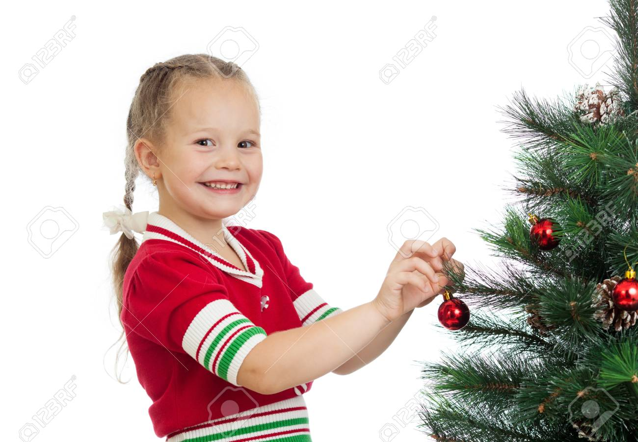 pretty preschool girl decorating Christmas tree isolated on white Stock Photo - 15036352