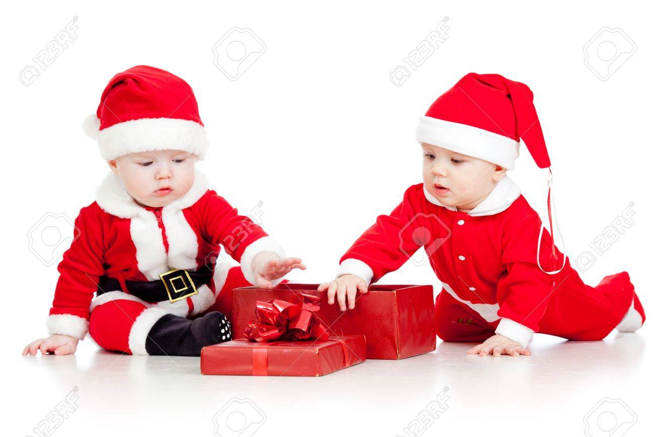 stock photo two funny small kids in santa claus clothes with gift box - Santa Claus Kids