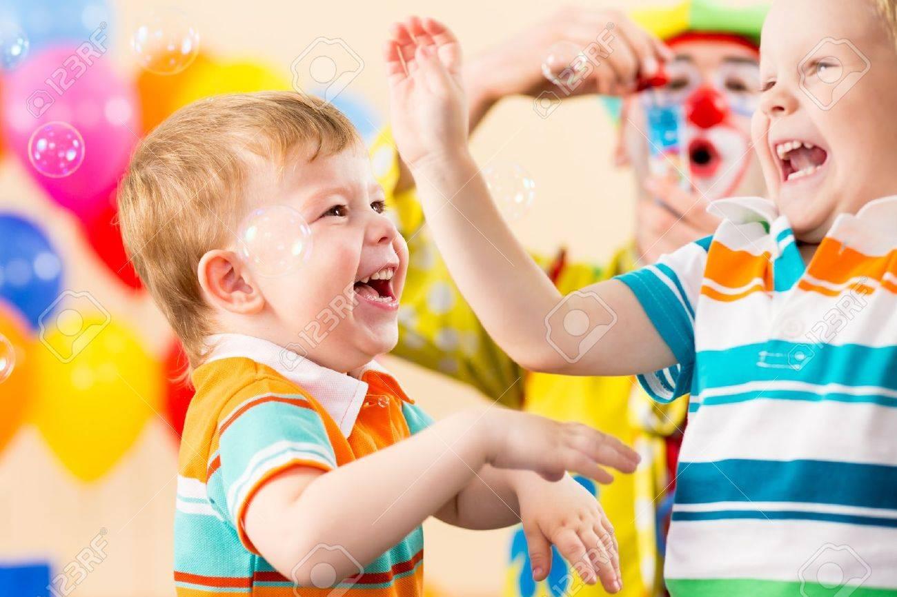 joyful kids with clown on birthday party Stock Photo - 15584092