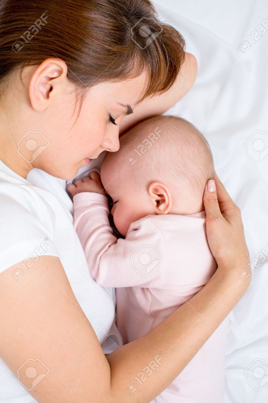 Young mother and her baby sleeping together Stock Photo - 15644981