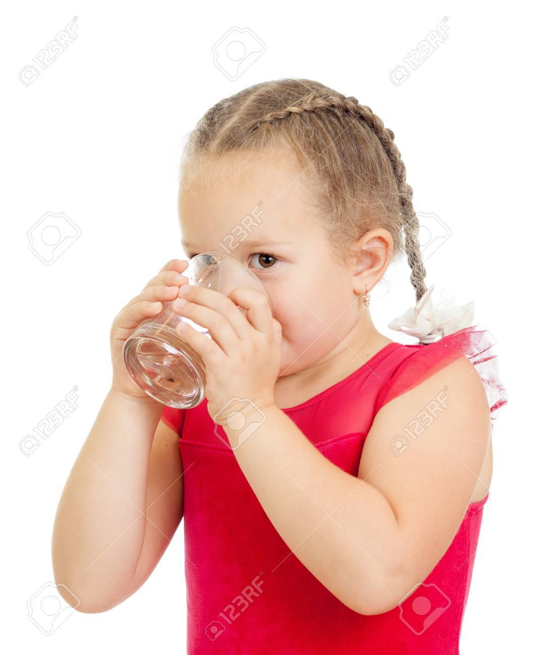 little girl drinking water from glass over white background Stock Photo - 15644951