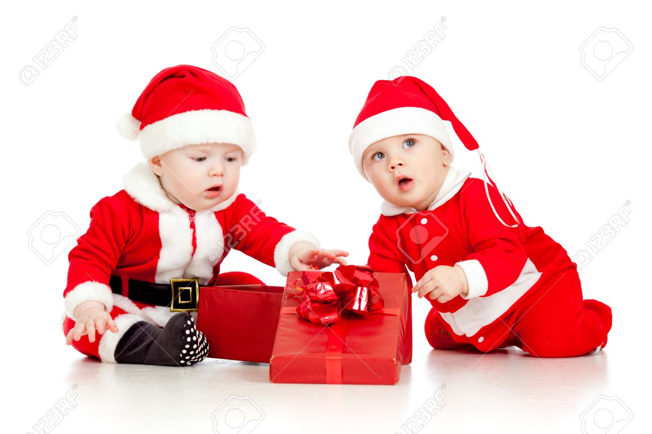 stock photo two funny small kids in santa claus clothes with gift box - Santa Claus Children