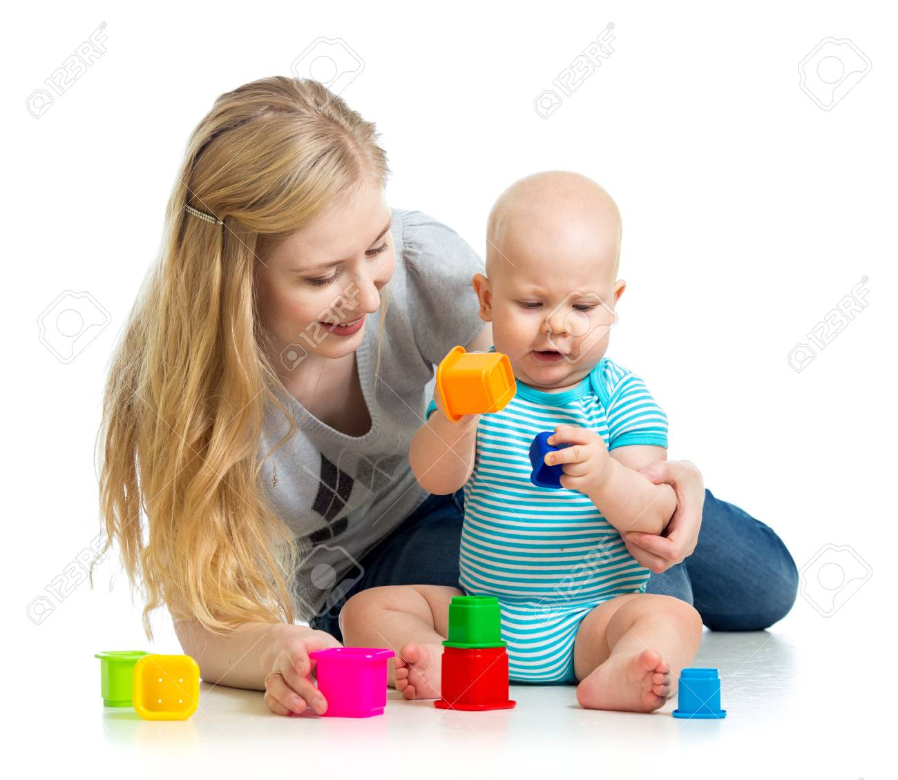 kid boy and mother playing together with cup toys Stock Photo - 17166080