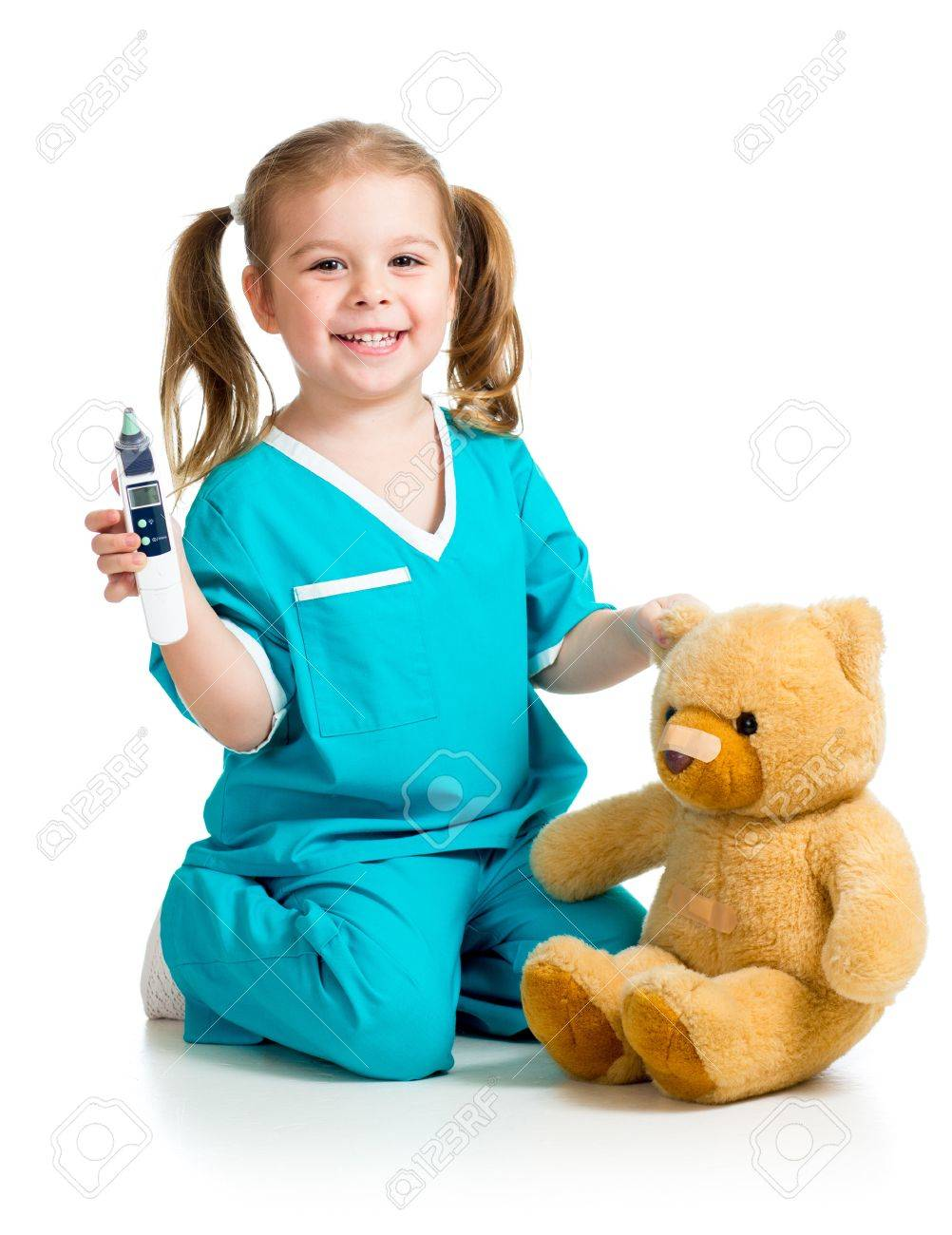 doctor girl playing and measuring  temperature toyl isolated on white background Stock Photo - 17283518