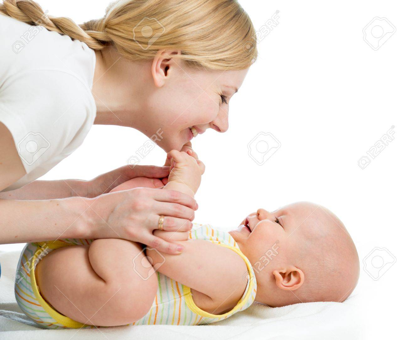 joyful mother playing with her baby infant Stock Photo - 17283525