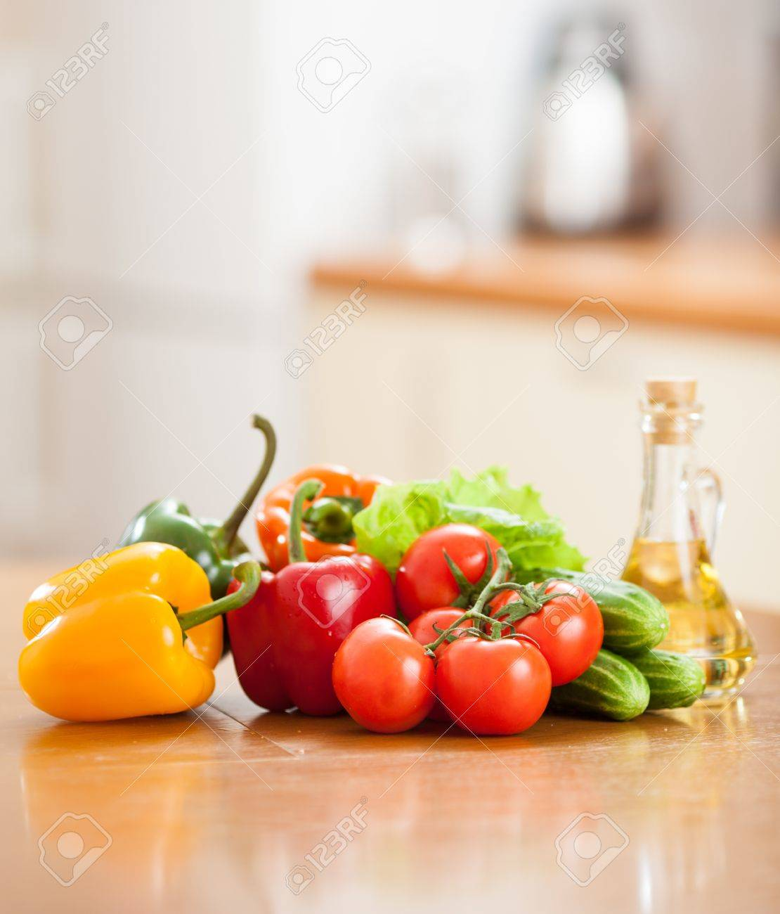 Kitchen Table With Food Healthy Food Fresh Vegetables And Bottle With Oil On The Kitchen